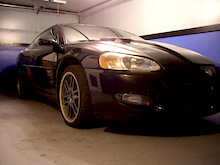 2002 Stratus, it is a sleeper. Will blow you away with 15psi of boost putting down over 400hp